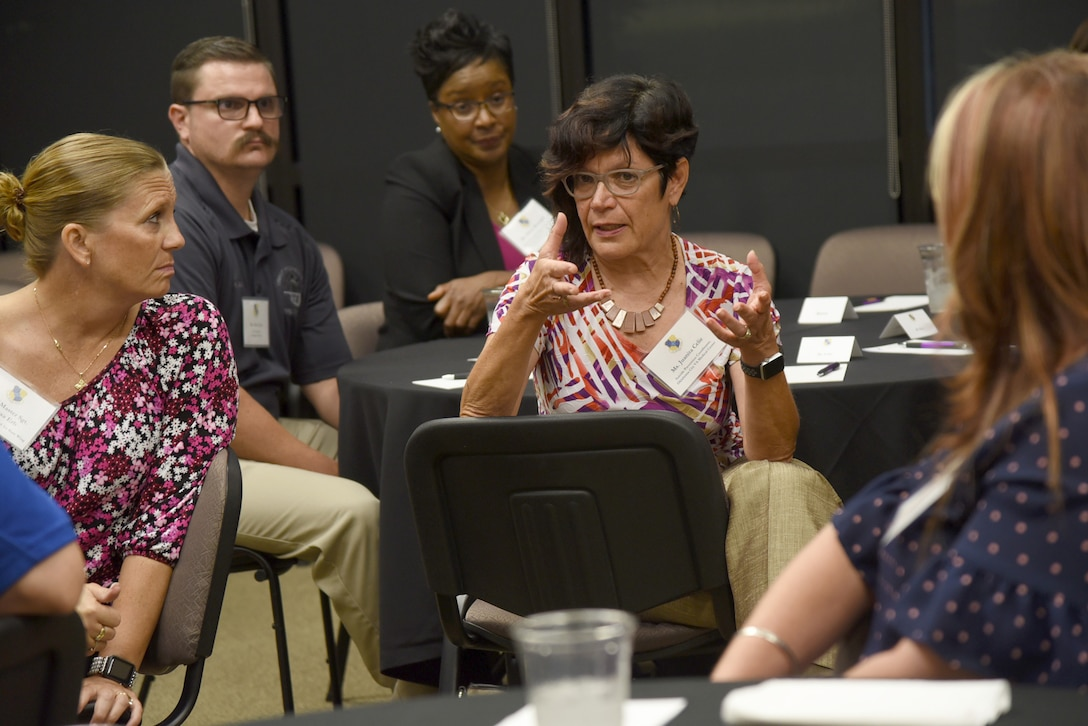 Juanita Ceile, a suicide prevention coordinator with the Oklahoma City VA Medical Center, shares her thoughts during a Mental Wellness Community Dinner Sept. 4, 2019, at the Midwest City Chamber of Commerce. Ceile was among the community members from various helping agencies who sat down with members of Team Tinker to share information and ideas on suicide prevention.