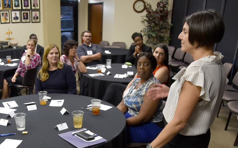 Maj. Denise Zona, 72nd Medical Group Mental Health Flight commander, talks about the importance of forming and maintaining relationships during a community dinner Sept. 4, 2019, at the Midwest City Chamber of Commerce. During the dinner, members of Team Tinker and representatives from community organizations shared ideas and experiences about suicide prevention.