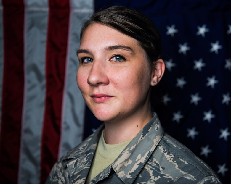 Airman 1st Class Whitney Hagood, 460th Force Support Squadron customer service technician, stands in front of the American flag, Sept. 10, 2019, on Buckley Air Force Base, Colo. Like herself, Hagood believes younger generations are still joining today because of the events of Sept. 11.