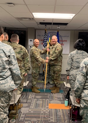 Col. John Gillespie, right, receives the guidon from Brig. Gen. Richard Kemble, 94th Airlift Wing commander, during an assumption of command ceremony Sept. 7, 2019. Gillespie assumed command of the 94th Aeromedical Staging Squadron. (Courtesy photo/Capt. Anna Sanchez)