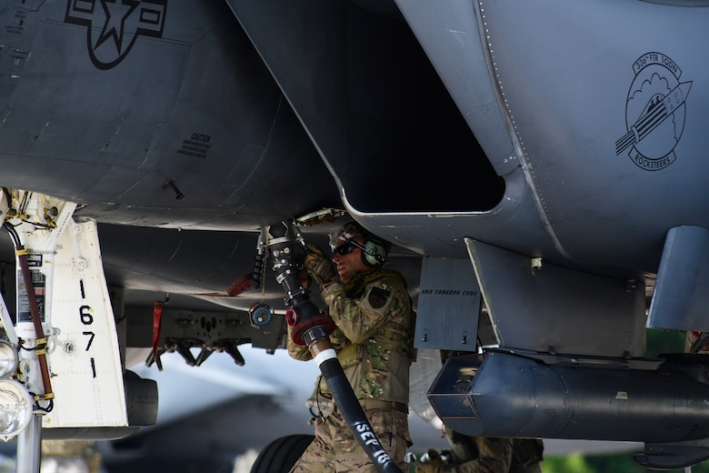 Tech. Sgt. Brandt Giambatista, 336th Aircraft Maintenance Unit electrical and environmental non-commissioned officer in charge, executes a hot-pit refuel on an F-15E Strike Eagle during the Combat Support Wing capstone, May 9, 2019, at Kinston Regional Jetport, North Carolina. After weeks of training on refueling, aircraft maintenance, security and more, 110 Airmen from 15 different bases separated into three different groups to put their newly found skills to the test. (U.S. Air Force photo by Senior Airman Kenneth Boyton)