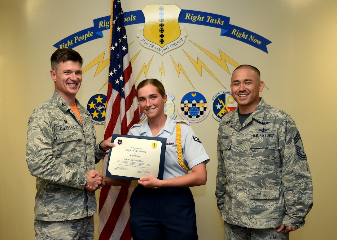 U.S. Air Force Col. Thomas Coakley, 17th Training Group commander, presents the 17th TRG Rope of the Month award to Airman 1st Class Raeana Bedker, 315th TRS student, at Brandenburg Hall on Goodfellow Air Force Base, Texas, September 6, 2019. Military Training Leaders present ropes to Airmen who display exceptional leadership qualities to lead their peers. (U.S. Air Force photo by Airman 1st Class Robyn Hunsinger/Released)