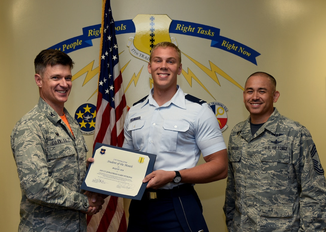 U.S. Air Force Col. Thomas Coakley, 17th Training Group commander, presents the 315th Training Squadron Student of the Month award to 1st Lt. Jonathan Earp-Pitkins, 315th TRS student, at Brandenburg Hall on Goodfellow Air Force Base, Texas, September 6, 2019. The 315th TRS's vision is to develop combat-ready intelligence, surveillance and reconnaissance professionals and promote an innovative squadron culture and identity unmatched across the U.S. Air Force. (U.S. Air Force photo by Airman 1st Class Robyn Hunsinger/Released)