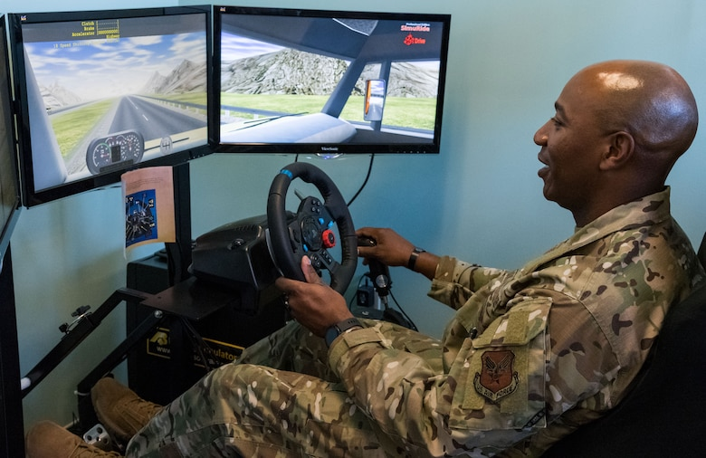 Chief Master Sgt. of the Air Force Kaleth O. Wright operates a semitruck driving simulator Sept. 3, 2019, at Dover Air Force Base, Del. Wright learned of the difficulties with maneuvering large vehicles and the importance of having licensed and certified drivers in the Air Force. (U.S. Air Force photo by Roland Balik)