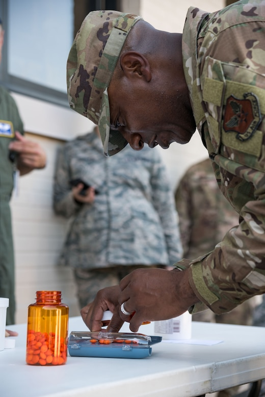 "Chief Master Sgt. of the Air Force Kaleth O. Wright participates in the 436th Medical Group's ""Best of the Best"" competition Sept. 3, 2019, at Dover Air Force Base, Del. Participants performed tourniquet application, litter carrying and pharmacy procedures during the competition. (U.S. Air Force photo by Roland Balik)"