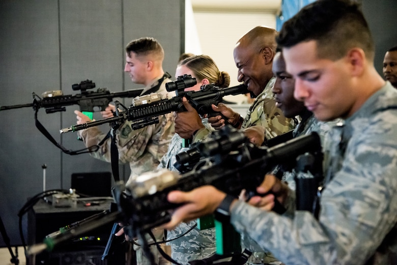 Chief Master Sgt. of the Air Force Kaleth O. Wright participates in a security forces simulator exercise with members of the 436th Security Forces Squadron at Dover Air Force Base, Delaware, September 3, 2019. The security forces visit was a part of a two-day tour of Dover AFB. (U.S. Air Force photo by Staff Sgt. Damien Taylor)