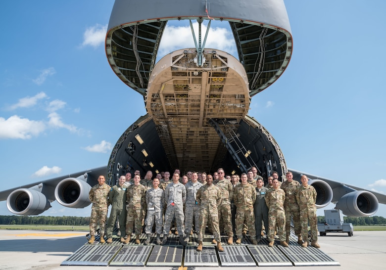Chief Master Sgt. of the Air Force Kaleth O. Wright poses for a photo with aircrew and maintenance personnel on the forward ramp of a C-5M Super Galaxy Sept. 4, 2019, at Dover Air Force Base, Del. Wright visited aircrew members and maintenance personnel during a two-day visit. (U.S. Air Force photo by Roland Balik)