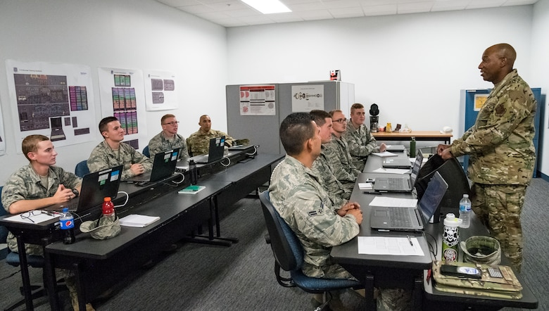 Chief Master Sgt. of the Air Force Kaleth O. Wright talks with Airmen from  Detachment 3, 373rd Training Squadron, Sept. 4, 2019, at Dover Air Force Base, Del. Wright shared stories and provided top-level support to Dover Airmen for their continued excellence. (U.S. Air Force photo by Roland Balik)