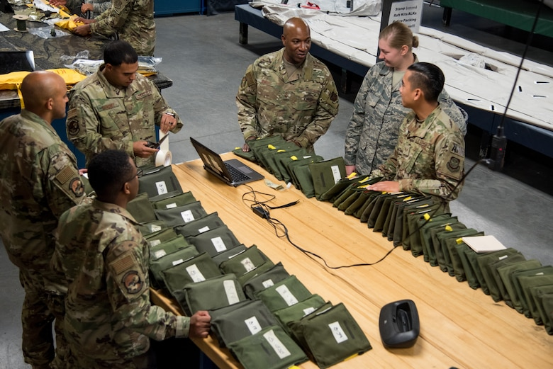 Chief Master Sgt. of the Air Force Kaleth O. Wright speaks with 436th Operations Support Squadron aircrew flight equipment Airmen at Dover Air Force Base, Del., Sept. 4, 2019. The AEF visit was a part of a two-day tour of Dover AFB. (U.S. Air Force photo by Staff Sgt. Damien Taylor)