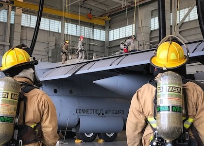 Firefighters from the 103rd Civil Engineer Squadron remove a simulated maintainer from a C-130H Hercules fuel tank during a confined space rescue exercise at the fuel cell and corrosion control facility, Bradley Air National Guard Base, East Granby, Conn. Sept. 8, 2019.