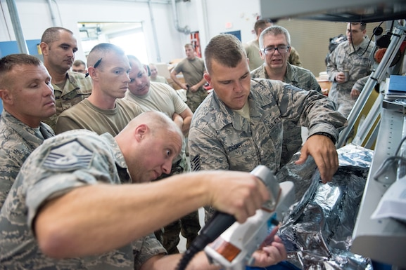 167th Airlift Wing aircraft maintainers, Master Sgt. David Miller, Tech. Sgt. Corey Chaney and Master Sgt. Michael Bowman demonstrate proper packing procedures for electrostatic discharge sensitive aircraft parts to 167th Logistics Readiness Squadron Airmen, Sept. 5, 2019. Airmen assigned to the 167th Airlift Wing helped reset the Air Force program that guides the packing procedures. (U.S. Air National Guard photo by Senior Master Sgt. Emily Beightol-Deyerle)