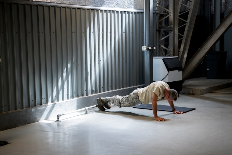 An Airman performs pushups Aug. 28, 2019, at Dover Air Force Base, Del. Prior to the completion of the new gym, Airmen only had a few mats and a toe bar to perform physical training activities close to their work center. (U.S. Air Force photo by Senior Airman Christopher Quail)