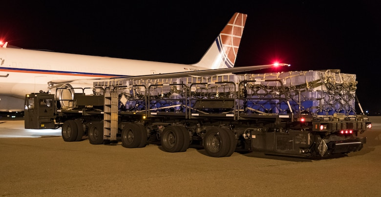 "A K-loader with five pallets waits to be marshalled into position by 436th Aerial Port Squadron ramp services personnel Sept. 8, 2019, at Dover Air Force Base, Del. The Air Transport International Boeing 757-200 aircraft, part of the Civil Reserve Air Fleet program, was contracted to transport cargo pallets and 30 Team Dover members to Fairchild AFB, Wash., participating in Mobility Guardian 2019. ""In support of exercise Mobility Guardian 2019, Air Mobility Command contracted commercial aircraft to simulate activating CRAF marking the first time, in a long time, AMC has exercised a commercial component of its wartime plan,"" said Maj. Adam Crane, AMC Headquarters CRAF Branch Chief, Scott AFB, Ill. (U.S. Air Force photo by Roland Balik)"