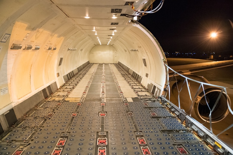 "The main deck cargo area of an Air Transport International Boeing 757-200 aircraft waits to be loaded by 436th Aerial Port Squadron ramp services personnel Sept. 8, 2019, at Dover Air Force Base, Del. The ATI aircraft, part of the Civil Reserve Air Fleet program, can accommodate up to 10 pallets. This 757-200 was contracted to transport cargo and 30 Team Dover members to Fairchild AFB, Wash., participating in Mobility Guardian 2019. ""This mission is multidimensional and will provide a greater understanding of the commercial airlift capabilities and requirements across Air Mobility Command and the commercial airlift enterprise,"" said Maj. Adam Crane, AMC Headquarters CRAF Branch Chief, Scott AFB, Ill. (U.S. Air Force photo by Roland Balik)"