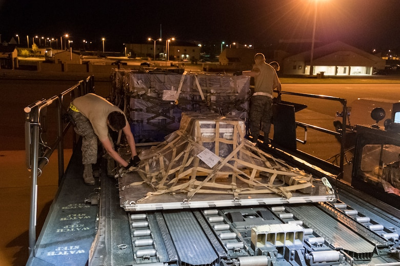 "Members of 436th Aerial Port Squadron ramp services section look over cargo netting prior to loading the pallets on an Air Transport International Boeing 757-200 aircraft Sept. 8, 2019, at Dover Air Force Base, Del. The ATI aircraft, part of the Civil Reserve Air Fleet program, was contracted to transport cargo and 30 Team Dover personnel to Fairchild AFB, Wash., participating in Mobility Guardian 2019. ""Air Mobility Command's commercial airlift partners are a vital part of our daily airlift missions around the world as well as our wartime effort,"" said Maj. Adam Crane, AMC Headquarters CRAF Branch Chief, Scott AFB, Ill. (U.S. Air Force photo by Roland Balik)"