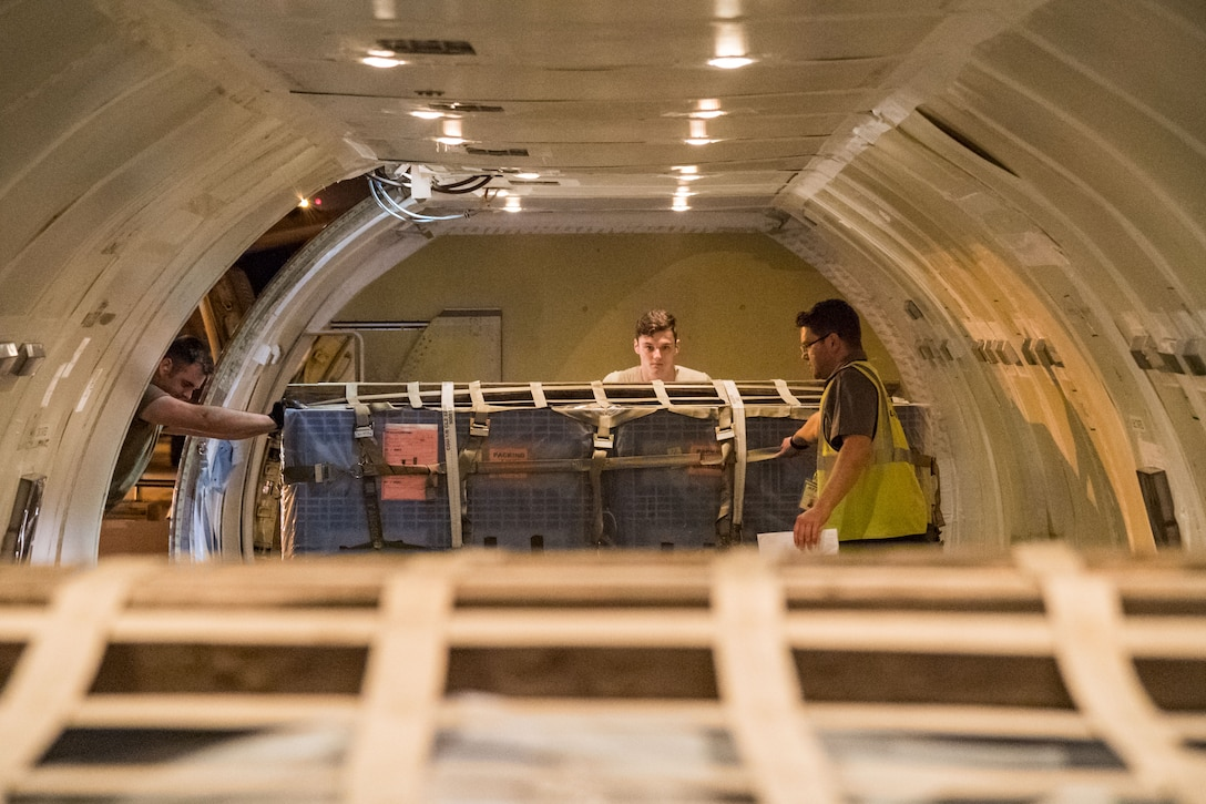 """Brian McDonald, Air Transport International senior loadmaster, watches a pallet being loaded Sept. 8, 2019, at Dover Air Force Base, Del. The ATI aircraft, part of the Civil Reserve Air Fleet program, was contracted to transport cargo and 30 Team Dover members to Fairchild AFB, Wash., participating in Mobility Guardian 2019. """"This mission is multidimensional and will provide a greater understanding of the commercial airlift capabilities and requirements across Air Mobility Command and the commercial airlift enterprise,"""" said Maj. Adam Crane, AMC Headquarters CRAF Branch Chief, Scott AFB, Ill. (U.S. Air Force photo by Roland Balik)"""