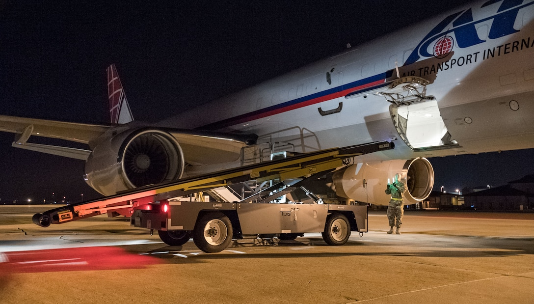 """Passenger services personnel from the 436th Aerial Port Squadron load baggage into the lower cargo hold of an Air Transport International Boeing 757-200 Sept. 8, 2019, at Dover Air Force Base, Del. The ATI aircraft, part of the Civil Reserve Air Fleet program, was contracted to transport cargo and 30 Team Dover members to Fairchild AFB, Wash., participating in Mobility Guardian 2019. """"This mission is multidimensional and will provide a greater understanding of the commercial airlift capabilities and requirements across Air Mobility Command and the commercial airlift enterprise,"""" said Maj. Adam Crane, AMC Headquarters CRAF Branch Chief, Scott AFB, Ill. (U.S. Air Force photo by Roland Balik)"""