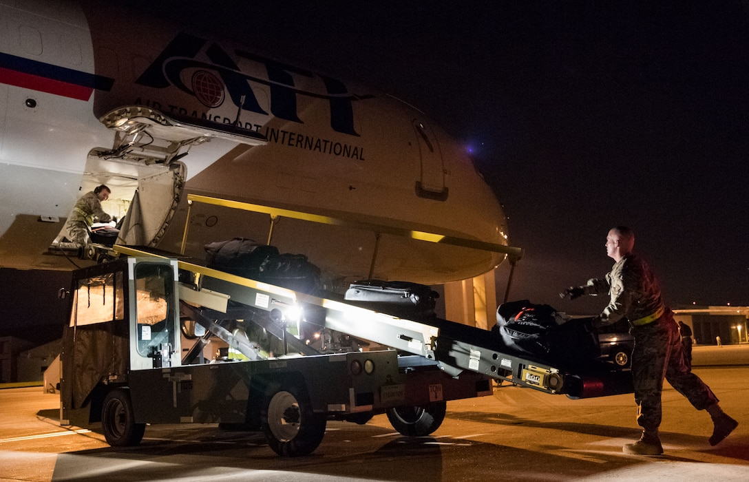 """Passenger services personnel from the 436th Aerial Port Squadron load baggage into the lower cargo hold of an Air Transport International Boeing 757-200 Sept. 8, 2019, at Dover Air Force Base, Del. The ATI aircraft, part of the Civil Reserve Air Fleet program, was contracted to transport cargo and 30 Team Dover members to Fairchild AFB, Wash., participating in Mobility Guardian 2019. """"Air Mobility Command's commercial airlift partners are a vital part of our daily airlift missions around the world as well as our wartime effort,"""" said Maj. Adam Crane, AMC Headquarters CRAF Branch Chief, Scott AFB, Ill. (U.S. Air Force photo by Roland Balik)"""