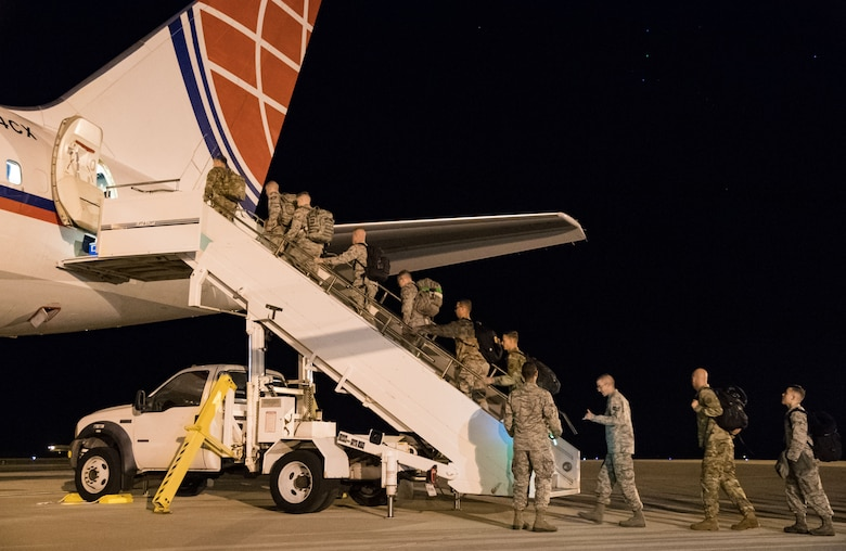 "Team Dover members use the step truck to enter the passenger seating section of an Air Transport International Boeing 757-200 Sept. 8, 2019, at Dover Air Force Base, Del. The ATI aircraft, part of the Civil Reserve Air Fleet program, was contracted to transport cargo and 30 Team Dover members to Fairchild AFB, Wash., participating in Mobility Guardian 2019. ""Air Mobility Command's commercial airlift partners are a vital part of our daily airlift missions around the world as well as our wartime effort,"" said Maj. Adam Crane, AMC Headquarters CRAF Branch Chief, Scott AFB, Ill. (U.S. Air Force photo by Roland Balik)"