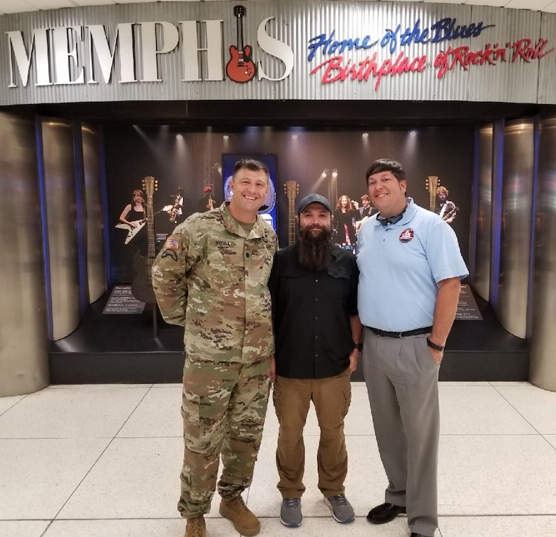 IN THE PHOTO, Memphis District Deputy Commander Lt. Col. Nathan Molica (left) and Jordan Bledsoe (right) greet Daniel Rocha upon his return home from a two year deployment with Task Force Essayons in Iraq. There he served as the Engineering Branch chief, a role for which he earned the Department of the Army Meritorious Civilian Service Award.