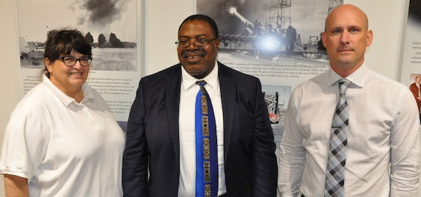 IMAGE: KING GEORGE, Va. (Aug. 20, 2019) - Dr. James Elele – a leading expert in the field of Verification, Validation, and Accreditation (VV&A) – is flanked by Naval Surface Warfare Center Dahlgren Division (NSWCDD) engineers Bonita Davia and Sam Koski at a two-day seminar sponsored by the NSWCDD Modeling and Simulation Community of Interest. Elele briefed about 115 scientists and engineers attending the VV&A seminar from NSWCDD, NSWCDD Dam Neck Activity, NSWC Indian Head Explosive Ordnance Disposal Technology Division, Marine Corps Systems Command, and Naval Air Station Patuxent River at the University of Mary Washington Dahlgren campus.  The course brought together a huge diversity of modeling and simulation disciplines to collaborate and learn approaches to verification, validation, and accreditation.