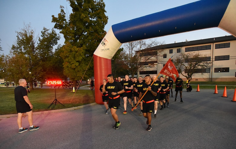 Maj. Gen. John Evans, commanding general, U.S. Army Cadet Command, cheers runners from 19th Engineer Battalion during the Fort Knox Army Substance Abuse Program's fourth annual Life Promotion 5K Run/Jog/Walk, on Sept. 6, 2019. About 700 participated in the kick-off event to National Suicide Awareness Month.