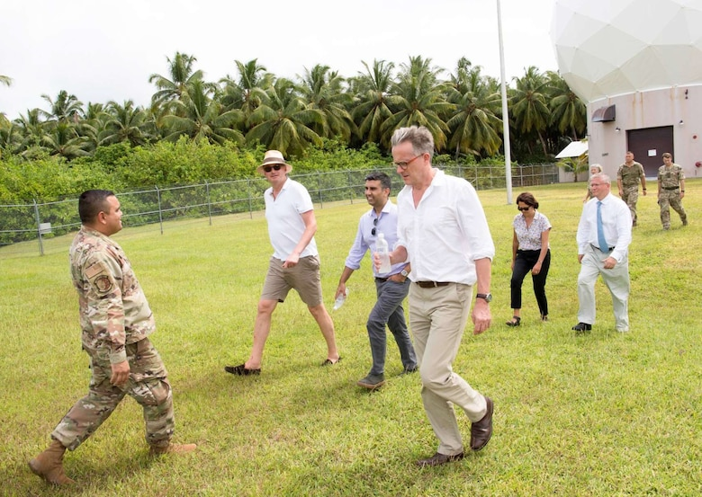Maj. Jesse Diaz, 21st Space Operations Squadron, Detachment 1 commander (left), guides members of British Parliament on a tour of the detachment during a visit to Diego Garcia, British Indian Ocean Territory, Aug. 29, 2019. The visitors received a mission brief specifying how the detachment's mission provides assured access and strategic connectivity to both space and cyberspace domains. (U.S. Air Force courtesy photo)