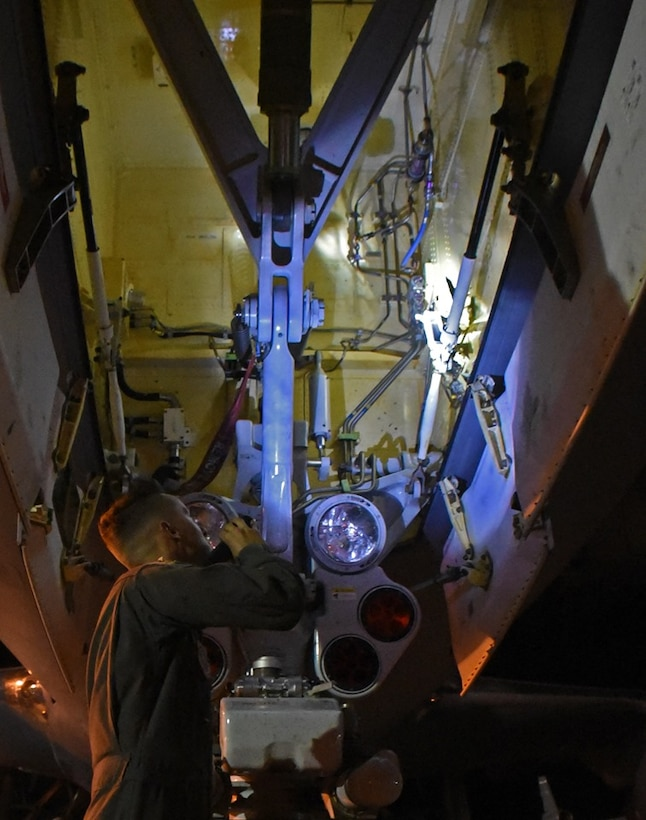 U.S. Air Force Staff Sgt. Eric Yates, 22nd Aircraft Maintenance Squadron crew chief from McConnell Air Force Base, Kansas, conducts a post-flight check of a KC-46 Pegasus Aug. 21, 2019, at Travis AFB, California. Yates, along with the rest of the KC-46 crew, worked with Travis' 60th Aerial Port Squadron to load the aircraft with life rafts and other cargo for the U.S. Navy's USS Port Royal. (U.S. Air Force photo by Senior Airman Christian Conrad)