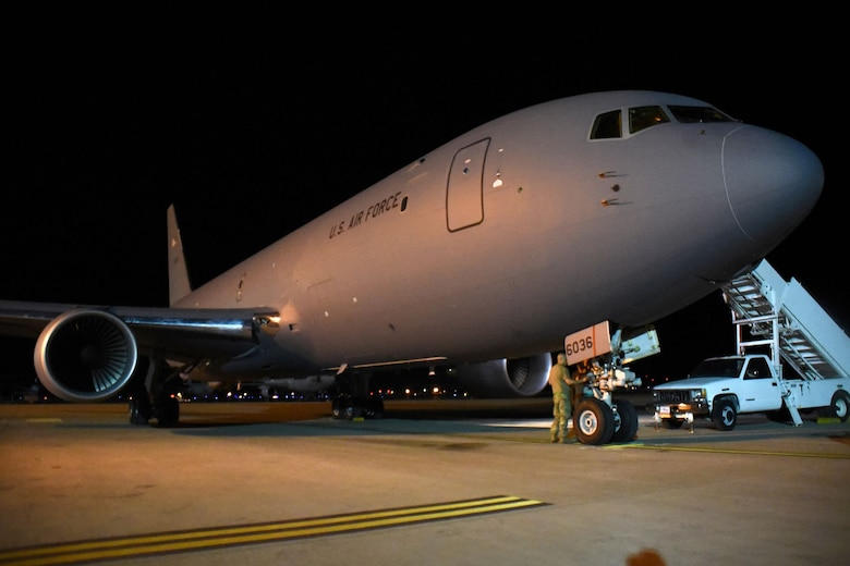 An Airman from McConnell Air Force Base, Kansas, conducts a post-flight check of a KC-46 Pegasus Aug. 21, 2019, at Travis AFB, California. The KC-46 aircrew coordinated with Travis' 60th Aerial Port Squadron during the trip, enlisting their help in loading supplies aboard the aircraft. (U.S. Air Force photo by Senior Airman Christian Conrad)