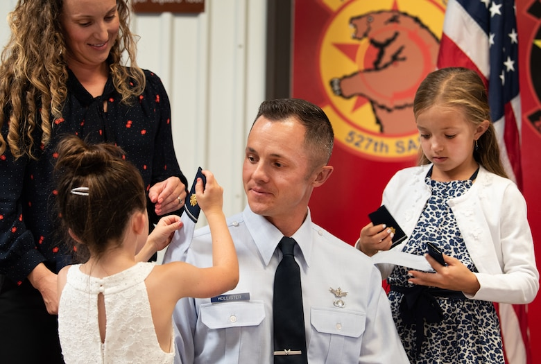 Maj. Scott Hollister's family members put on his new rank during a promotion ceremony Sept. 8, 2019.