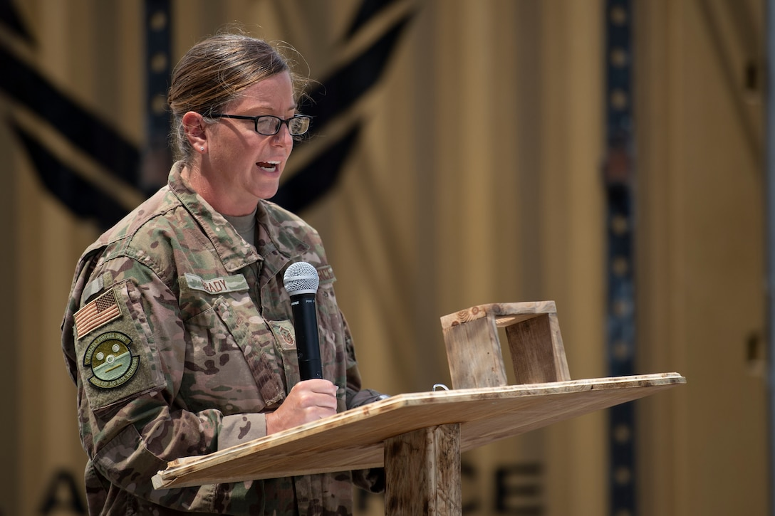 U.S. Air Force Master Sgt. Shannon Brady, 475th Expeditionary Air Base Squadron first sergeant, speaks about the history and symbolism of the American flag at a ceremony at Camp Simba, Kenya, Aug. 26, 2019. The 475th EABS raised the flag for the first time since the base operating support-integrator  mission started in 2017, signifying the change from tactical to enduring operations. (U.S. Air Force photo by Staff Sgt. Lexie West)