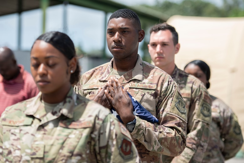 U.S. Air Force Airmen from the 475th Expeditionary Air Base Squadron perform flag detail during a ceremony at Camp Simba, Kenya, Aug. 26, 2019. The 475th EABS raised the flag for the first time since the base operating support-integrator mission started in 2017, signifying the change from tactical to enduring operations. (U.S. Air Force photo by Staff Sgt. Lexie West)