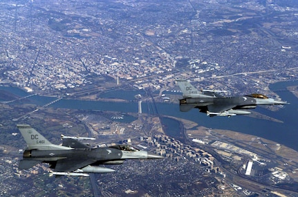 Two US Air Force (USAF) F-16C Fighting Falcon aircraft from the 121st Fighter Squadron, 113th Wing, District of Columbia (DC) Air National Guard (ANG), fly over the nation's Capital, during a Combat Air Patrol mission in support of Operation NOBLE EAGLE.