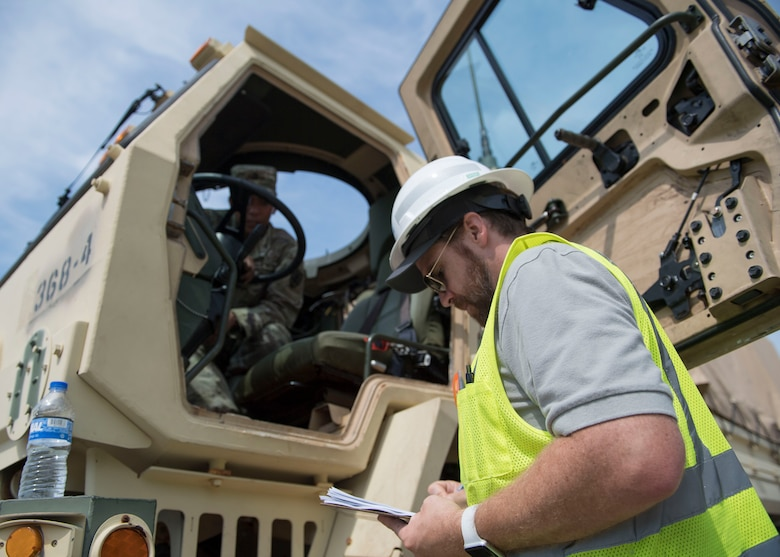 A Port of Virginia dockworker takes notes during training for a cargo transportation exercise at Fort Story, Virginia, Aug. 20, 2019.