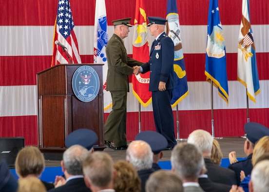 Marine Corps Gen. Joe Dunford, chairman of the Joint Chiefs of Staff, and Air Force Gen. John W. Raymond, commander, U.S. Space Command and Air Force Space Command, deliver remarks at the USSPACECOM Recognition and Establishment Ceremony at Peterson Air Force Base, Colorado Sept. 9, 2019.