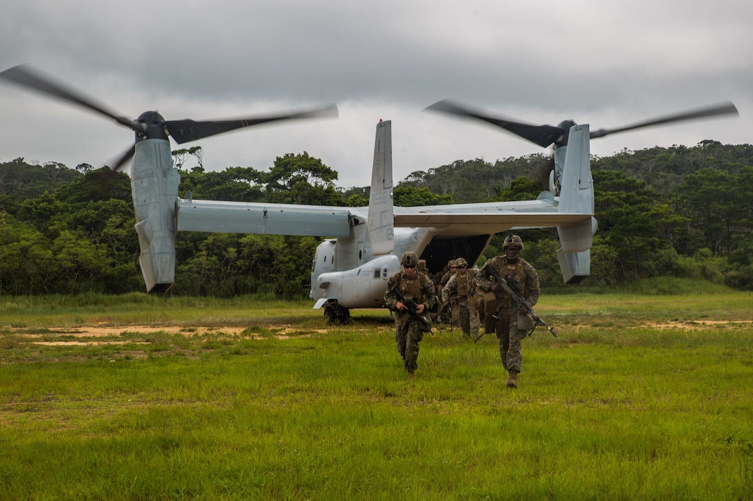 Marines with Echo Company, Battalion Landing Team, 2nd Battalion, 1st Marines, 31st Marine Expeditionary Unit, exit an MV-22B Osprey tiltrotor aircraft during a long-range raid in the Central Training Area, Okinawa, Japan, Aug. 14, 2019. The 31st MEU and Amphibious Squadron 11, aboard Wasp Amphibious Ready Group ships, conducted a series of sequential operations which simulated naval expeditionary combined-arms maneuver from amphibious assets to shore, utilizing Marine Air-Ground Task Force capabilities integrated across all warfighting domains.