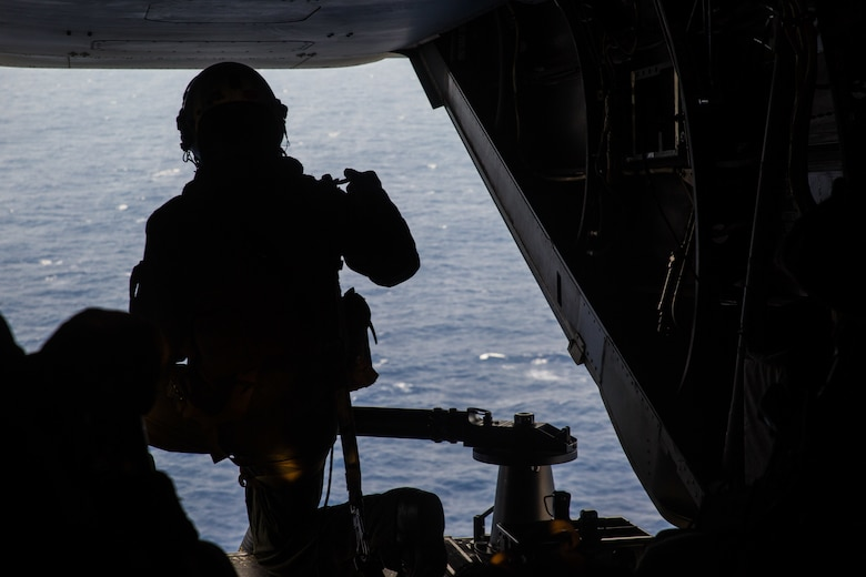 A Marine with Marine Medium Tiltrotor Squadron 265, 31st Marine Expeditionary Unit, prepares to fire an M240B medium machine gun after a simulated long-range raid over the Philippine Sea, Aug. 14, 2019. The 31st MEU and Amphibious Squadron 11, aboard Wasp Amphibious Ready Group ships, conducted a series of sequential operations which simulated naval expeditionary combined-arms maneuver from amphibious assets to shore, utilizing Marine Air-Ground Task Force capabilities integrated across all warfighting domains.