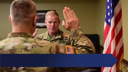 Arkansas Adjutant General Maj. Gen. Kendall Penn Swears in a soldier in the Arkansas National Guard