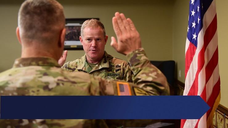 Arkansas Adjutant General Maj. Gen. Kendall Penn Swears in a soldier in the Arkansas National Guard