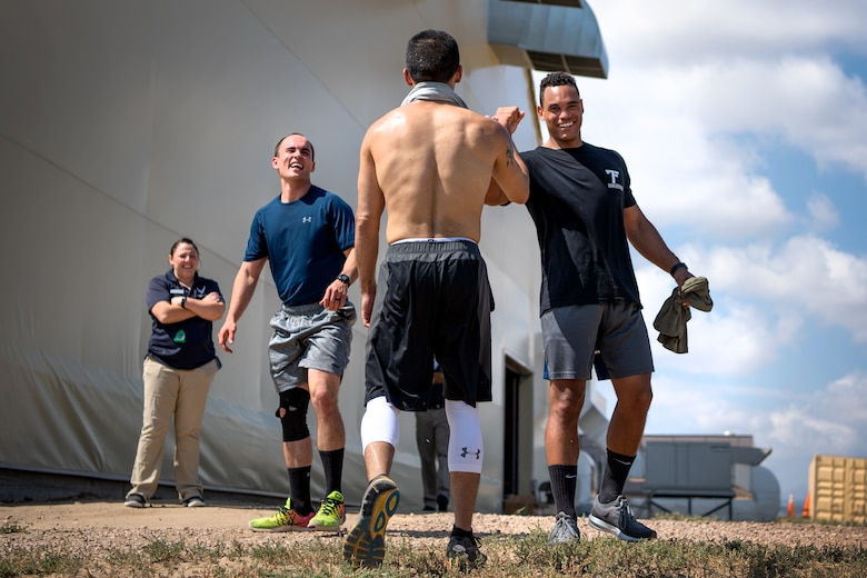 Competitors show support for each other during the DriTri Fitness Competition Sept. 6, 2019, at Schriever Air Force Base, Colorado.