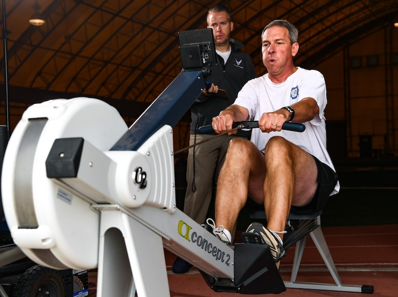 Theodore Koch, with the Air Force Tactical Exploitation of National Capabilities, competes on the rowing machine during the DriTri Fitness Competition on Sept. 6, 2019, at Schriever Air Force Base, Colorado.
