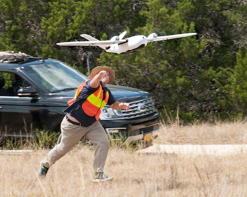 Ethan Jacobs, unmanned aerial system engineer, launches a UAS during a field test Sept. 4 at Joint Base San Antonio-Camp Bullis. The UAS was equipped with Light Detection and Ranging, multi-spectral sensors and machine-learning algorithms to map, survey and inventory habitat for the golden-cheeked warbler. The field test will help the Air Force determine if UAS technology can characterize habitat better, faster and cheaper than current methods.