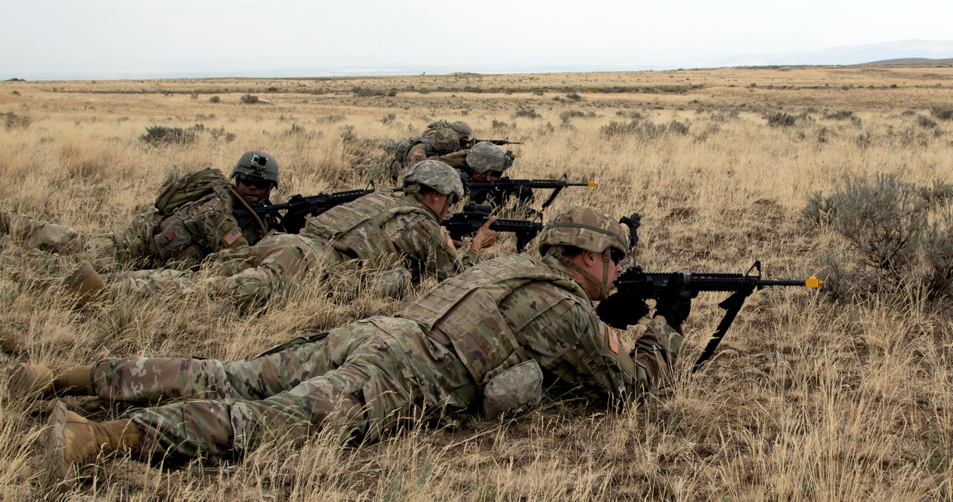 Soldiers lay in the ready position during Rising Thunder 19.