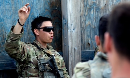 2nd Lt. Andrew Shinsako, platoon leader for Alpha Company, 1st Platoon, 1st Battalion, 178th Infantry Regiment provides feedback to his troops after a blank fire interation during Rising Thunder 19.