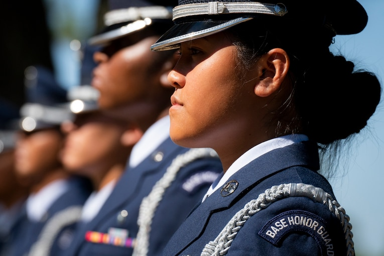 A row of airman stand at attention.