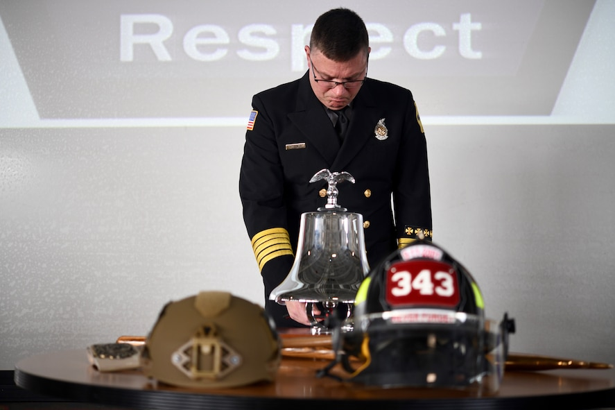 Sean Quinby, 4th Civil Engineer Squadron fire chief, rings the ceremonial bell during the 9/11 Remembrance Ceremony at Seymour Johnson Air Force Base, North Carolina, Sept. 11, 2019.