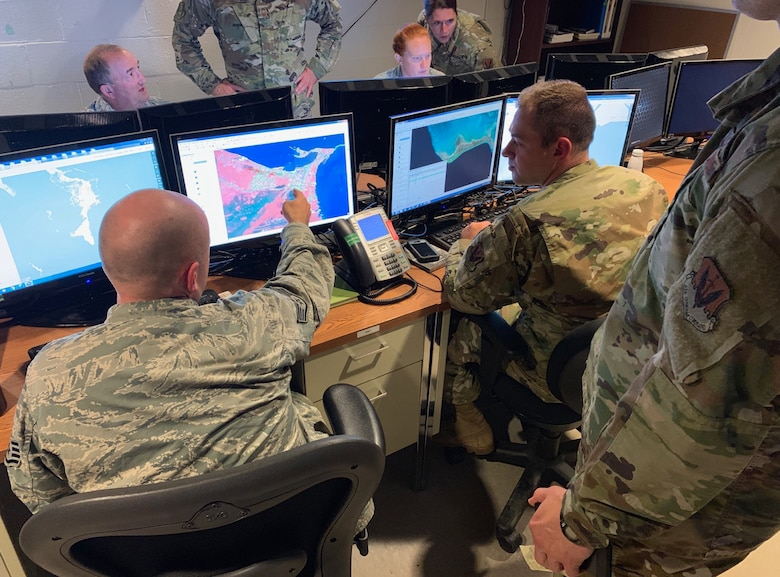 U.S. Air Force Airmen from the 118th Wing, Tennessee Air National Guard use their imagery analysis skills to assess damage in the Bahamas from Hurricane Dorian Sept. 6, 2019 at Berry Field Air National Guard Base, Nashville, Tenn. The products produced by the Airmen are sent to higher headquarters, who then use them to more effectively direct first responders on the ground. (U.S. Air National Guard photo by Master Sgt. Jeremy Cornelius)