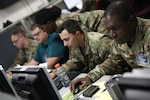 U.S. service members and civilians along with partner nation service members work to improve tactical-level cyber operations skills against a live opposing force at the Joint Training Facility in Suffolk, Va. during U.S. Cyber Command's annual exercise.