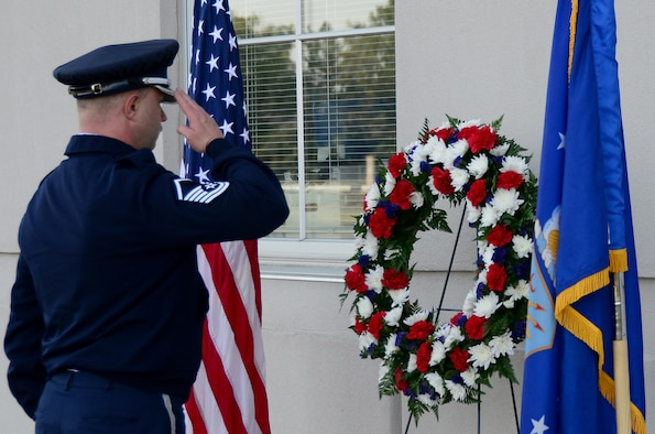 Master Sgt. Shawn McKellop, 445th Airlift Wing Honor Guard member, lays a wreath of the base of the Maj. LeRoy W. Homer, Jr. Operations Building, Sept. 11, 2019, during a Patriot Day ceremony. Maj. LeRoy Homer was the First Officer on United Airlines Flight 93 that crashed in Shanksville, Pa. at 10:03 a.m. Sept. 11, 2001. Homer was a member of the 445th Airlift Wing's 356th Airlift Squadron from 1995 to 2000.