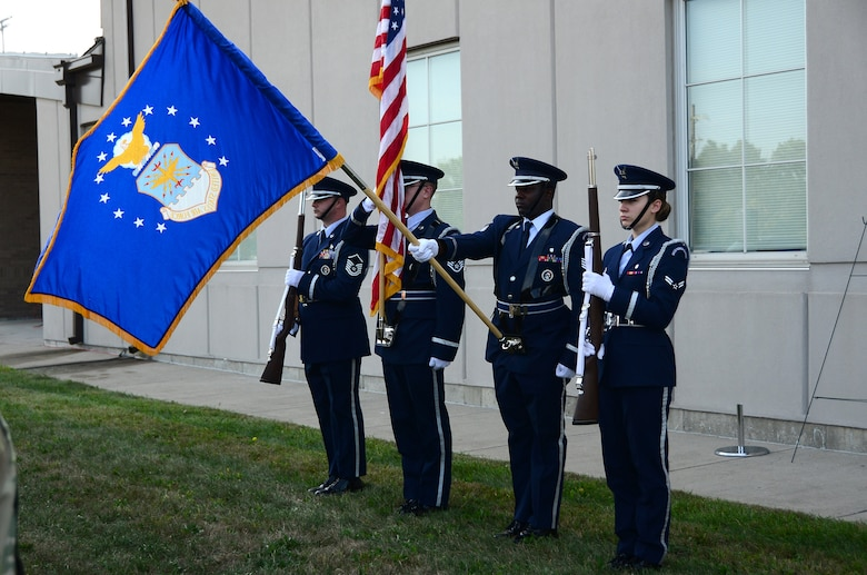 The 445th Airlift Wing Honor Guard presents the Colors in front of the Maj. LeRoy Homer, Jr. Operations Building Sept. 11, 2019 during a Patriot Day ceremony. More than 100 members of the wing gathered on the lawn of the Major LeRoy W. Homer, Jr. Operations building to honor those who lost their lives Sept. 11, 2001